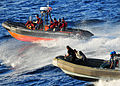 Defense.gov News Photo 100530-N-7643B-437 - U.S. Coast Guardsmen from USCGC Cutter Mellon WHEC 717 sailors from USS Vandegrift FFG 48 and Indonesian sailors conduct combined operations.jpg