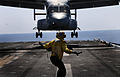 Defense.gov News Photo 110511-N-7508R-002 - A landing signal enlisted assigned to the multipurpose amphibious assault ship USS Bataan LHD 5 guides an MV-22B Osprey assigned to Marine Medium.jpg