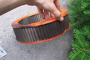 Air filter - Auto engine air filter clogged with dust and grime