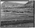 Distant view of historic complex, view to southeast - Trail Shop, 2750 North Fork Highway, Cody, Park County, WY HABS WYO,15-CODY.V,3-1.tif