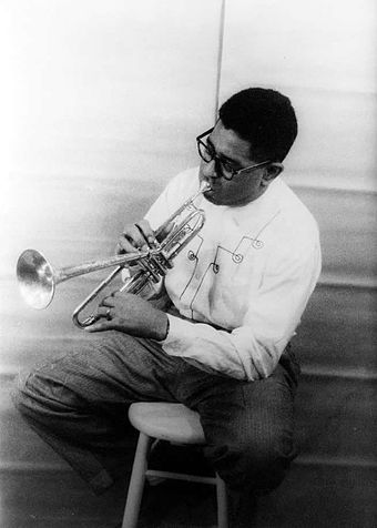 Gillespie performing in 1955 Dizzy Gillespie playing horn 1955.jpg