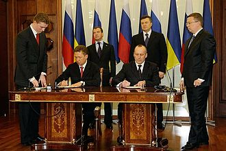 Kharkiv Pact - Signing of the deal reached at the Kharkiv summit at 21 April 2010 by Alexei Miller and Yevhen Bakulin (with Dimitry Medvedev and Viktor Yanukovych standing in the background)