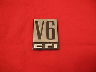 Dodge Caravan - Fender badge originally used on V6 equipped Caravans