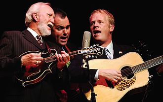 Doyle Lawson - Doyle Lawson (left) and his band harmonize during the 2006 NEA National Heritage Fellows concert.
