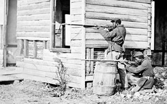 Cover (military) - Two American soldiers in 1864 take cover. One flattens himself against the wall while the other crouches behind a barrel