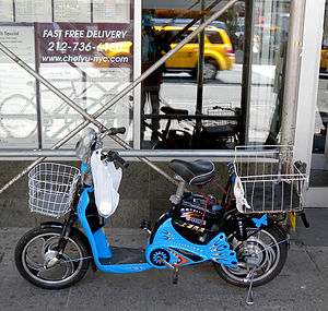 An electric bicycle chained on West 34th Stree...