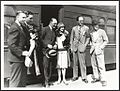 E.J. Tait and Anna Pavlova (with four unidentified men in front of a train carriage, 1926 or 1929) (9445633555).jpg