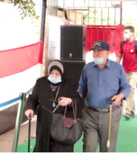 An elderly Egyptian couple inside a polling station