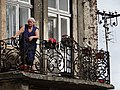 Elderly Woman on Balcony - Przemysl - Poland (35975618520).jpg