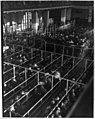 """Emigrants in """"pens"""" at Ellis Island, New York, probably on or near Christmas -note the decorations LCCN2012646352.jpg"""