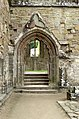 Entrance to church from cloister at Tintern Abbey.jpg