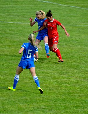 Esra Manya - Esra Manya (red) playing for Turkey girls' U-17 in the 2015 UEFA Women's Under-17 Championship qualification – Elite round match against Finland.