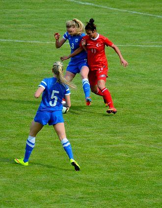 Esra Manya - Esra Manya (red) playing for Turkey girls' U-17 in the 2015 UEFA Women's Under-17 Championship qualification – Elite round match against Finland.
