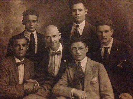 Debs sitting with five young socialists in Chicago, with the man on the far right, Louis Eisner, being the father of Stanford University professor Elliot Eisner Eugene Debs with Young Socialists.jpg