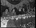 Evita con ministros de Perón en un banquete.jpg