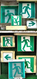 File:Exit signs for sale at the market (2533881028).jpg