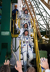 Expedition 31 crew wave goodbye.jpg