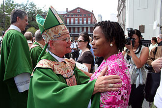 Roman Catholic Archdiocese of New Orleans - Archbishop Hughes greets parishioners in front of St. Louis Cathedral after the first services in New Orleans since Hurricane Katrina more than a month earlier.