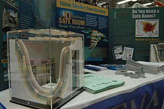 Safe room - FEMA Mitigation provides information on building safe rooms inside homes for areas of the country prone to high winds. A mockup of a safe room is shown in the foreground.