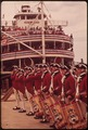 FIFE AND DRUM CORPS PERFORM ON LOUISVILLE WATERFRONT, WHERE PADDLEWHEEL STEAMBOAT IS DOCKED - NARA - 543960.tif