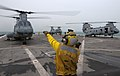 Flickr - Official U.S. Navy Imagery - A Sailor signals a helicopter to turn off its engine on the flight deck..jpg