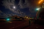 Flickr - Official U.S. Navy Imagery - Flight deck personnel taxi an AV-8B Harrier jet..jpg