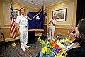 Flickr - Official U.S. Navy Imagery - Rear Adm. Victorino G. Mercado, left, unfurls his one-star flag..jpg
