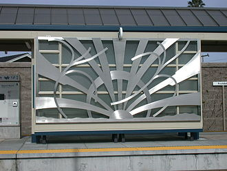 Fruitdale station - Metal screens that adorn the shelter at the Fruitdale VTA light rail station