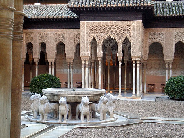 The Court of the Lions, a Moorish masterpiece, at the Alhambra palace (Granada, Spain)