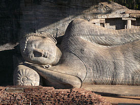 Lord Buddha entering Parinibbana at the Gal Vihara in Polonnaruwa. The Gal Viharaya in Polonnaruwa has four large images of the Buddha carved out of a single rock.