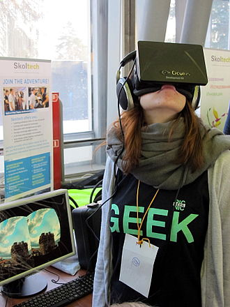 Geek - A visitor at Geek Picnic (Moscow) wearing a Geek shirt and a VR headset