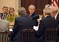 George W. Bush sits with Margaret Spellings and Norman Mineta during Academic Competitiveness Council.jpg
