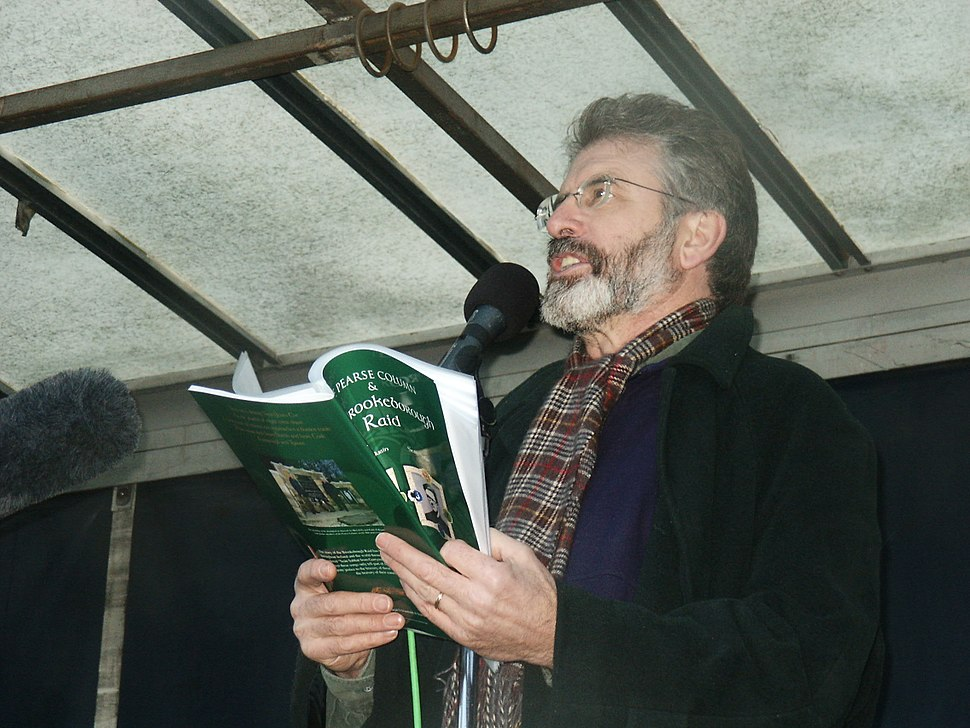 Gerry Adams reading into mic