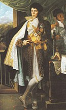 Color painting of a long-faced European man with black hair. He wears early 1800s court dress. His long blue coat with gold braiding is opened to show white breeches and long white stockings.