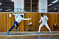 Greek Epee fencers. Evening training with guests at Athenaikos Fencing Club. On the left Ilias Konstantinidis (Victoria Fencing Club).jpg