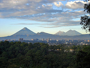 View of Guatemala City with the Agua, Fuego and Acatenango volcanoes in the background.