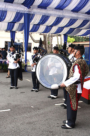 Gurkha Contingent - Members of the Singapore Police Force Gurkha Contingent Pipes and Drums Platoon performing at the Police Week Carnival 2005.