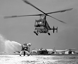 Kaman HH-43 Huskie - A USAF Huskie aids a practice firefighting operation at Cam Ranh Bay Air Base, Vietnam in 1968