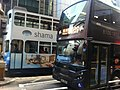 HK Sheung Wan morning Des Voeux Road Central Train body ads Shama bus 109 Nov-2011.jpg