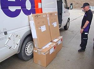 Trucker hat - FedEx driver wearing mesh trucker hat.