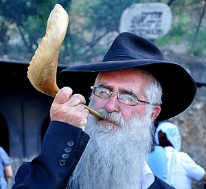 Shofar blowing - A Haredi man blowing a shofar
