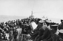 Soldiers standing on the deck of a ship