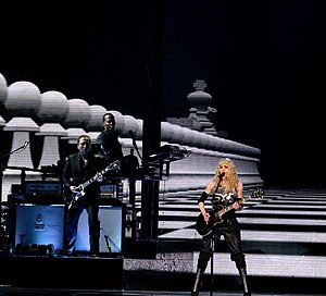 "Hung Up - Madonna performing a rock version of  ""Hung Up"" on the Sticky & Sweet Tour (2008)."