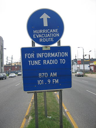 Hurricane evacuation - A hurricane evacuation route sign on Tulane Avenue in New Orleans, Louisiana, after Hurricane Katrina. The signage below suggests tuning to WWL Radio or sister station WLMG for emergency information.