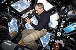 ISS-58 David Saint-Jacques takes pictures of the Earth from inside the Cupola.jpg