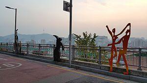Ihwa Mural Village - Naksan Park steel sculptures, N Seoul Tower seen in distance, 2015.