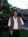 "In April 2001 I needed a photo of myself for an upcoming conference or event. Colen grabbed this photo of me outside our building. Long gone is the tie I wore in 1992, and I am in my vest and ""sneak (120398360).jpg"
