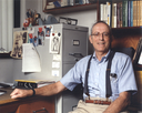 Irwin Fridovich in his office.png