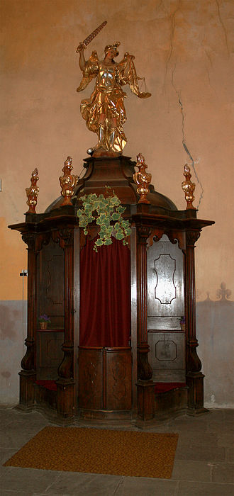 Sacrament of Penance - A confessional in the Bohemian style, in Jaroměř, Czech Republic.