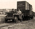 Jeep switcher with flatbed trailer (cropped).jpg
